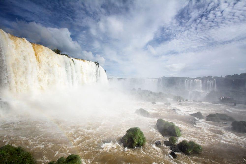 foam of iguazu falls thundering into rocks