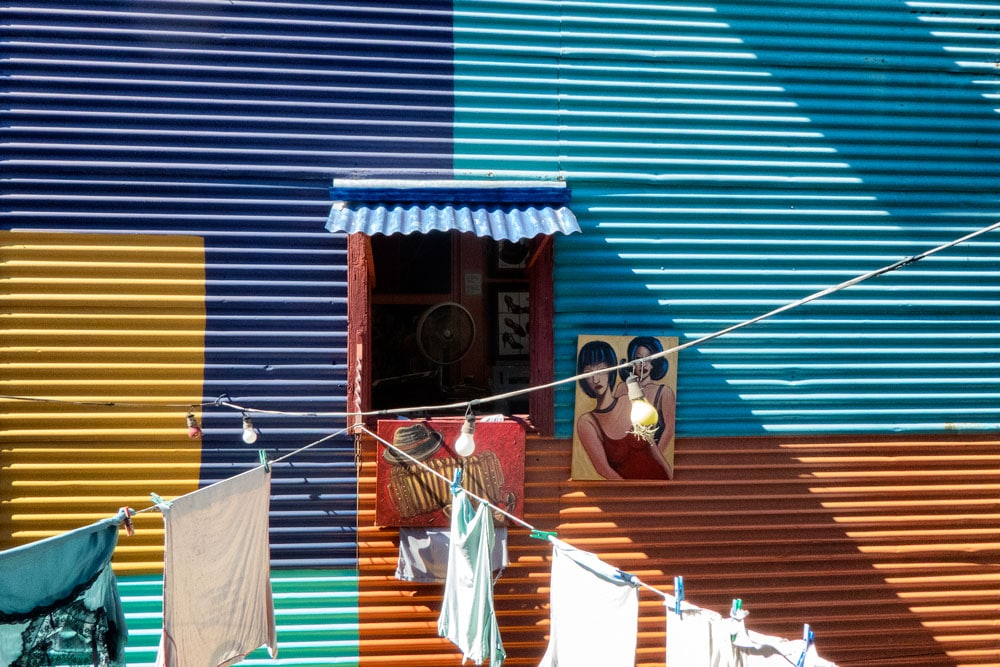 multicolr building with window and laundry strung outside in la boca buenos aires argentina