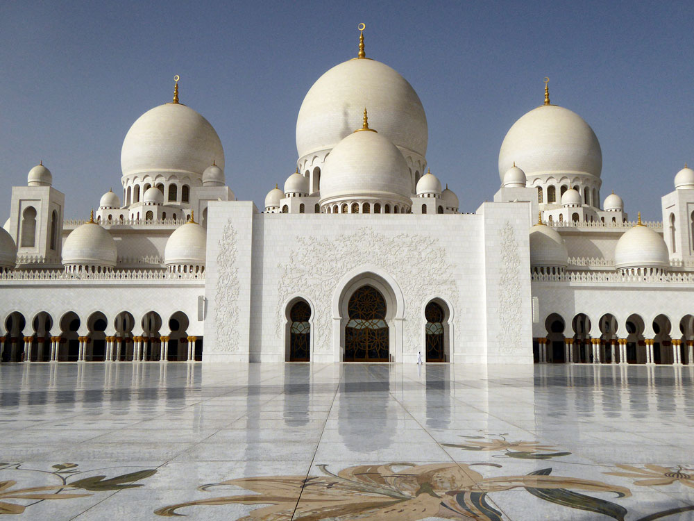 man walking in front of gleaming exterior of mosque during 3 days in abu dhabi