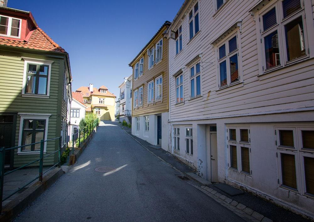 painted wooden buildings in street in bergen norway