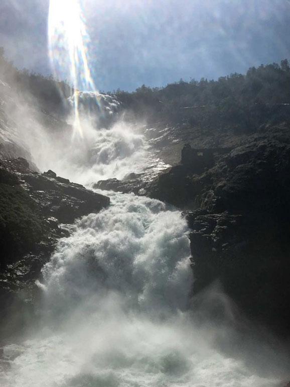 waterfall thundering down hillsdie seen from flam railway