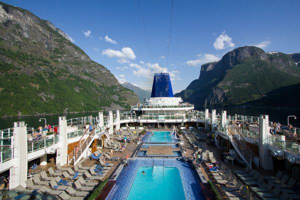 deck of cruise ship sailing along norwegian fjords