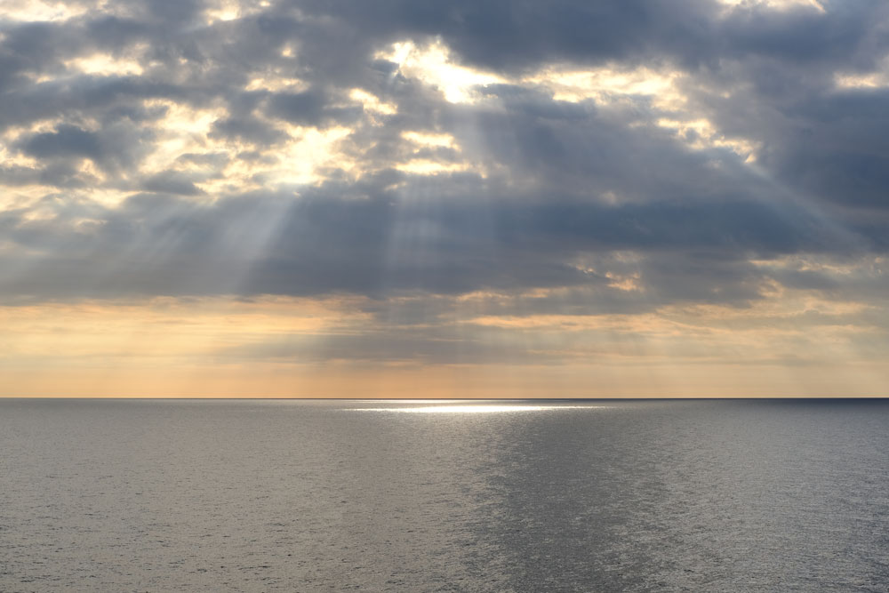 crepuscular-rays over ocean at sunset
