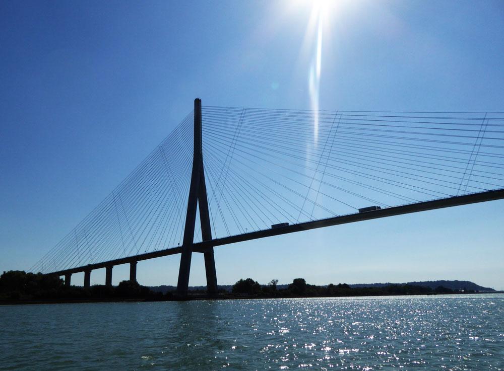 massive suspension bridge against blue sky in normandy france