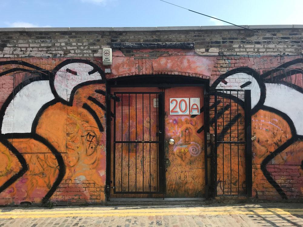 abstract brick lane street art across doorway