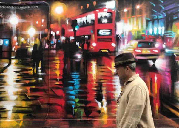 man walking by London scene street art on wall