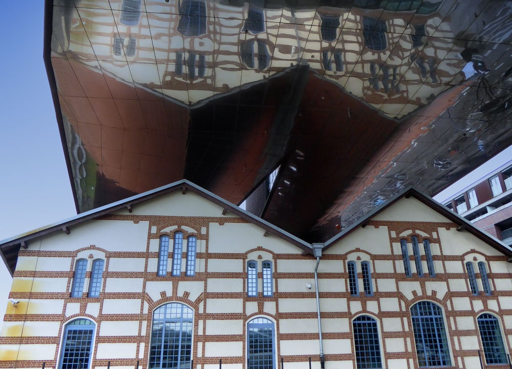 upside down reflection of gab;ed building in krakow poland