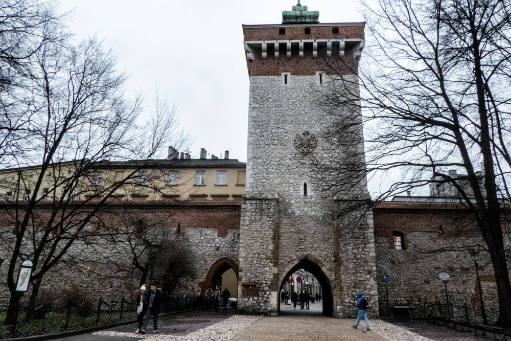 old gate to walled city at start of krakow walking tour