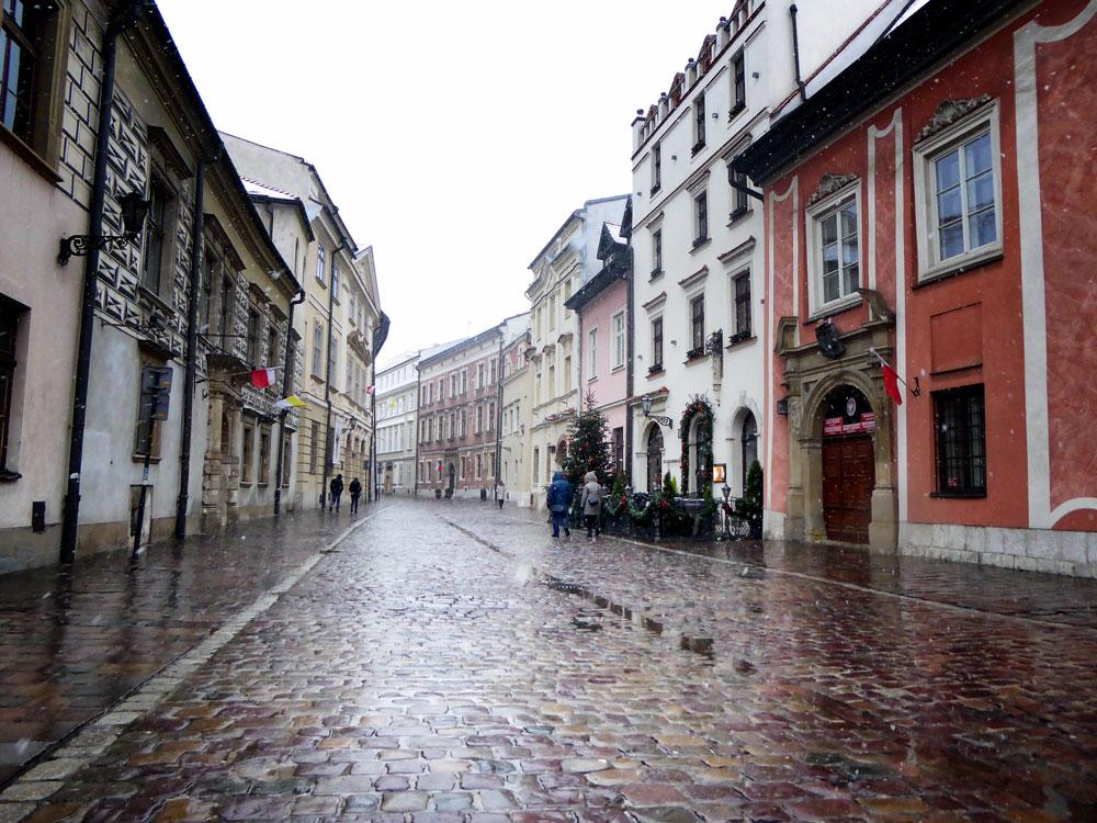 cobblestone street in rain in old street in krakow
