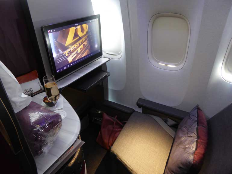 business class airplane seat in Qatar Airways QSuite review
