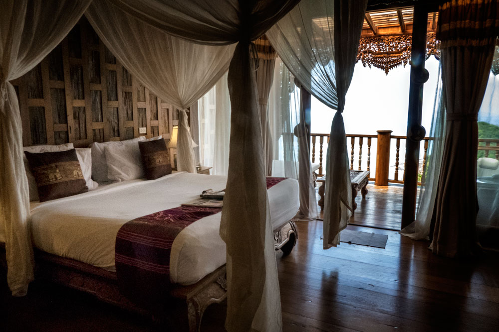 elegant bedroom with carved wooden furniture considered in santhiya resort koh yao yai review