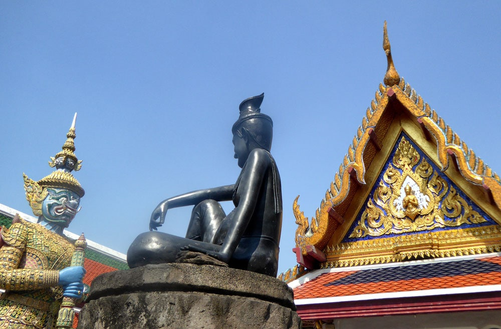 colourful statues and roof of pagoda in bangkok temple