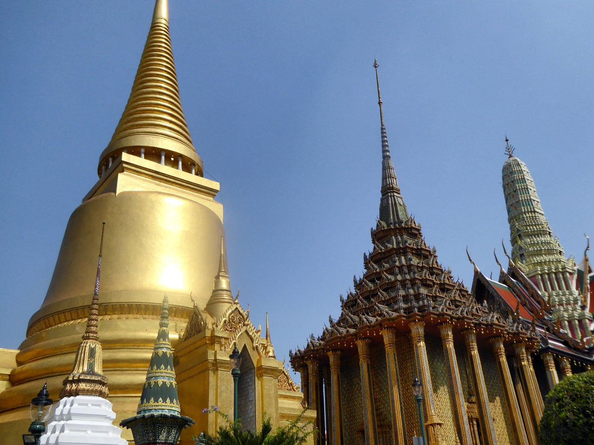 gold and stone tops of temple buildings seen on diy bangkok boat tour