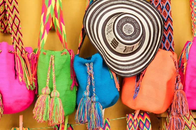 brightly colored bags and hats on display