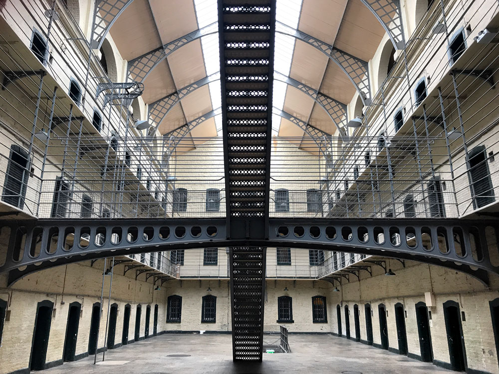 interior of kilmainham gaol with galleried cells and staircase