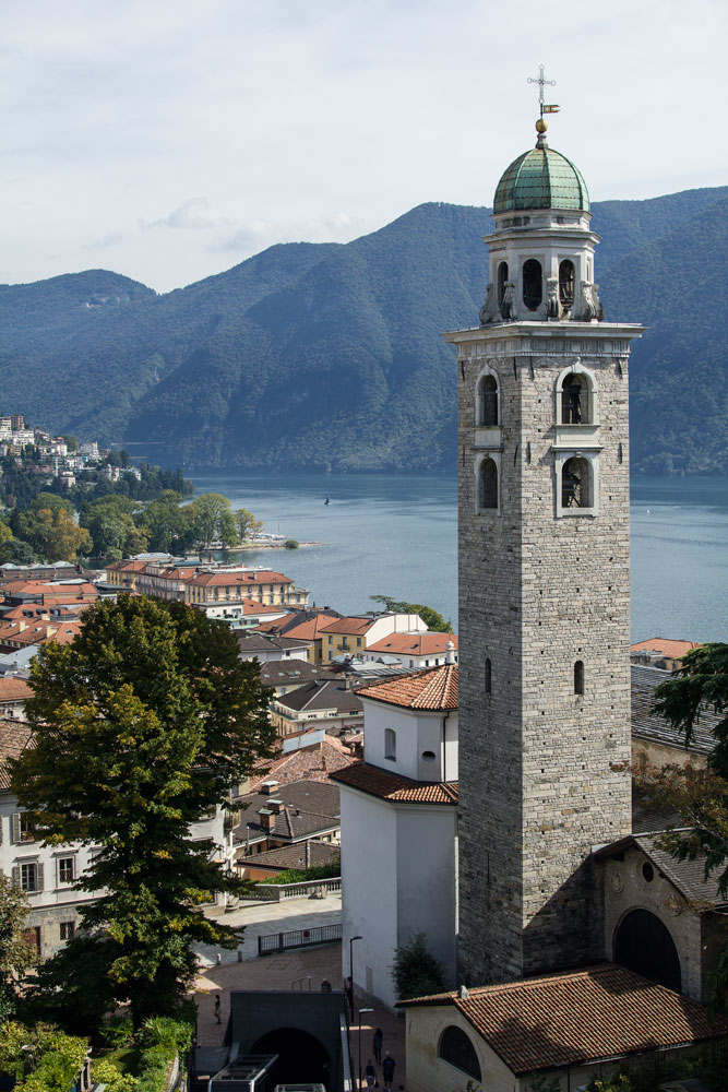 church bell tower by lake