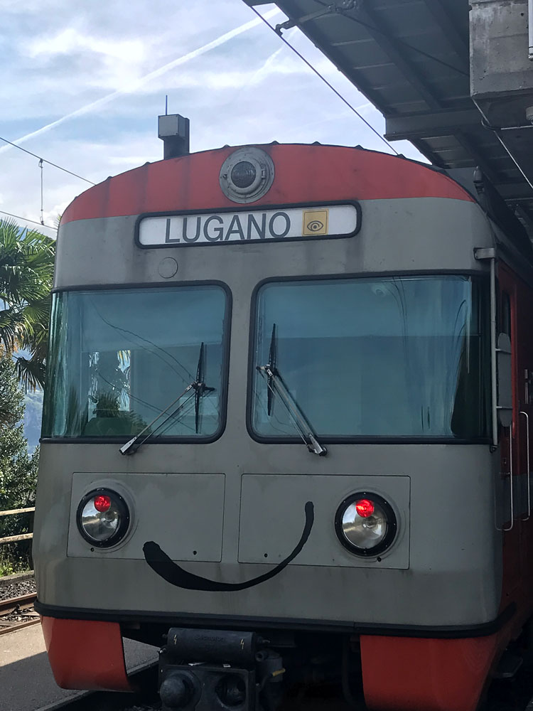 swiss train that can be used with the ticino ticket with a smiley face painted on front