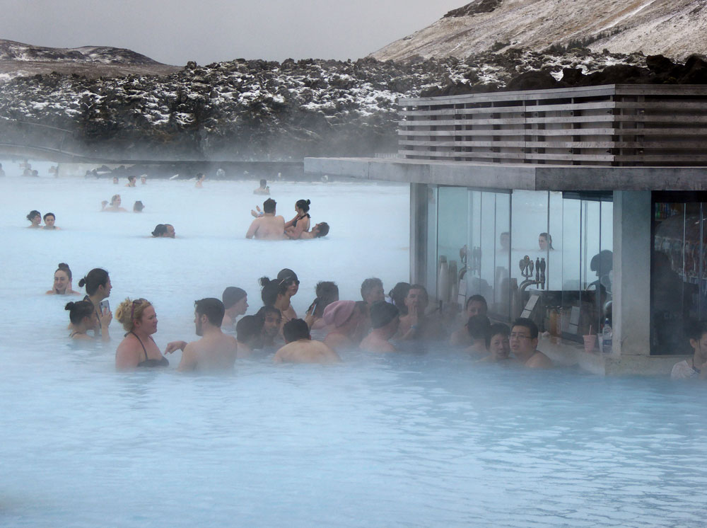 people drinking at swim up bar in blue lagoon iceland