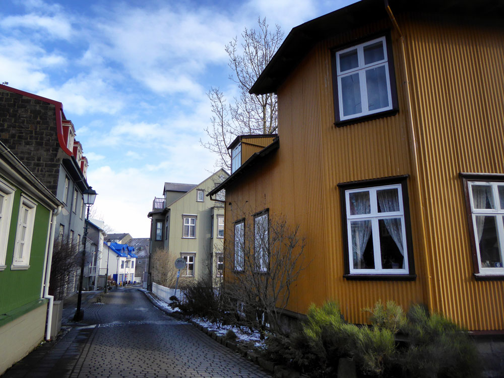 brightly coloured houses on street in Grjóti village included on 1-day Reykjavik itinerary