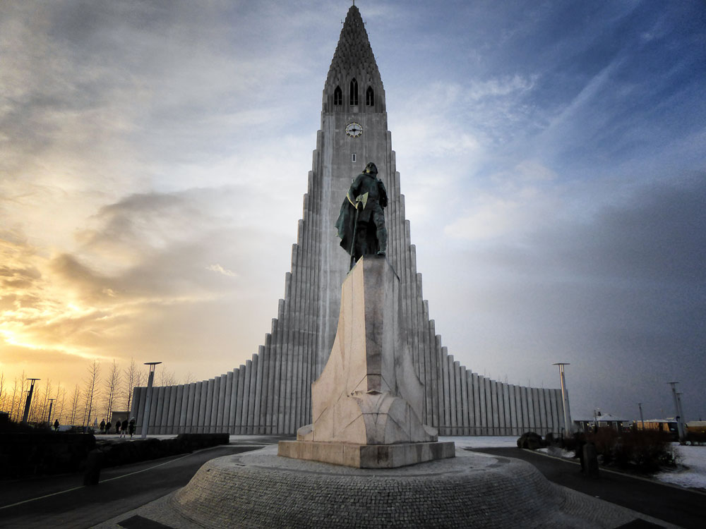 modern church of Hallgrimskirkja at sunset on iceland solo travel itinerary