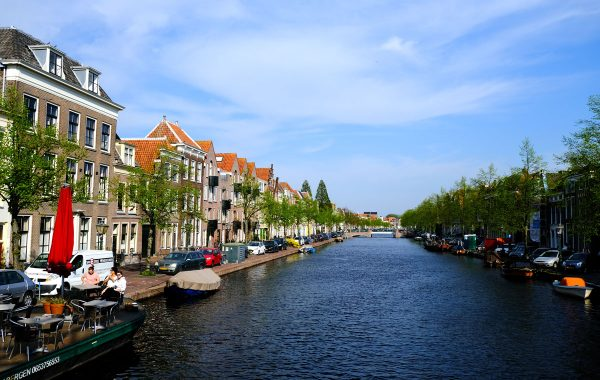 canal with buildings on each side an a boat moored