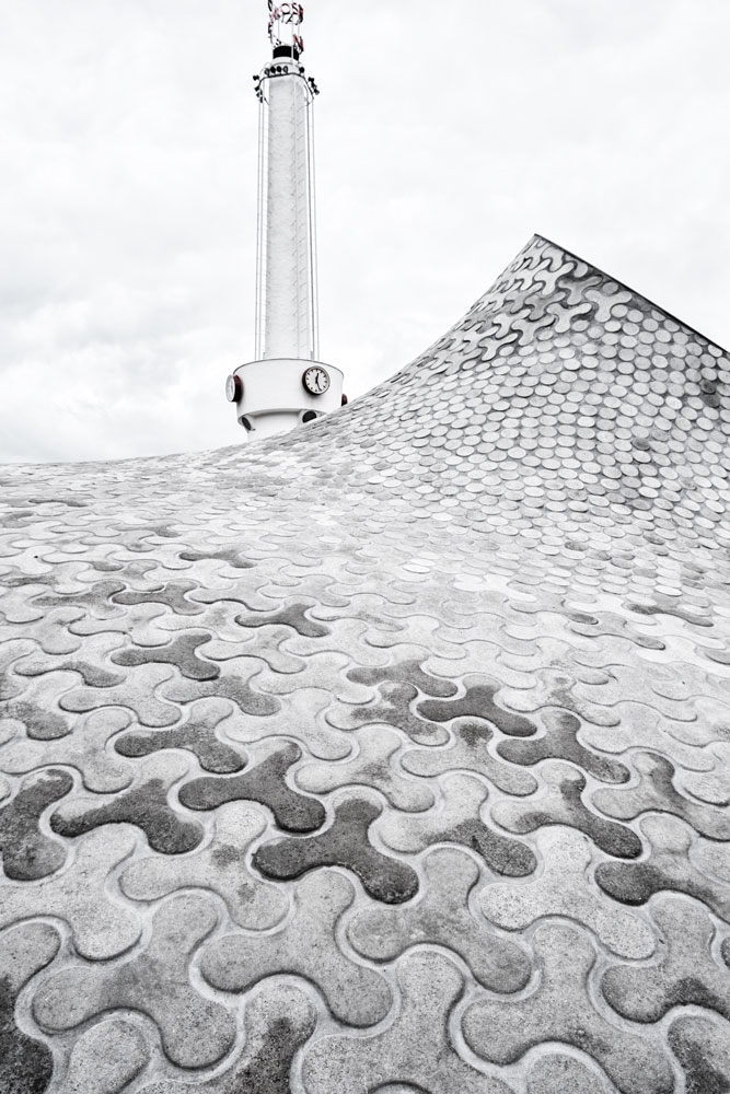 undulating paving stones and tower of amos rex in helsinki