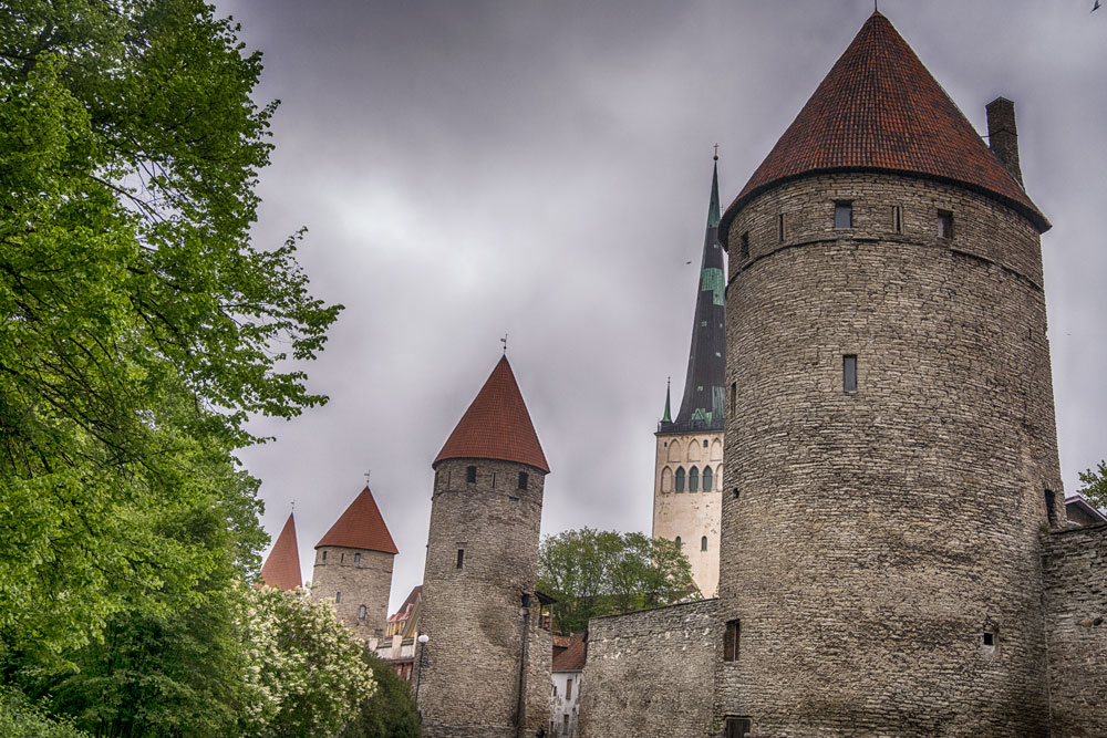 ancient city wall and towers of tallinn is the first stop on a one day in tallinn itinerary