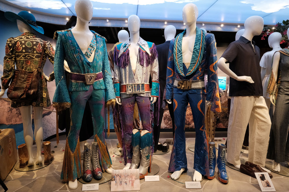 stage costumes of the group abba on dummies displayed at the abba museum the first stop on a 1 day stockholm itinerary