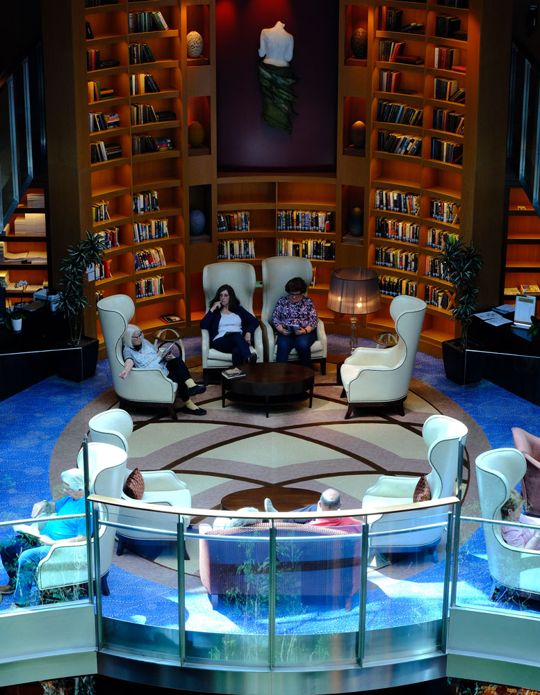 people sitting in library on board a cruise ship