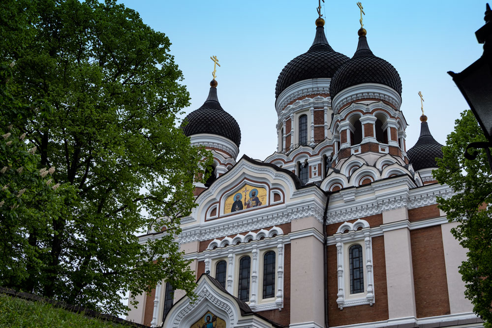 brick exterios and onion domes of Alexander Nevsky Cathedral seen whilst sightseeing in tallinn