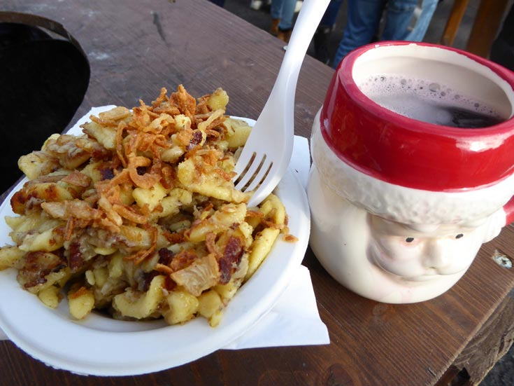 plate of food-at-christmas-market-vienna with mug of mulled wine