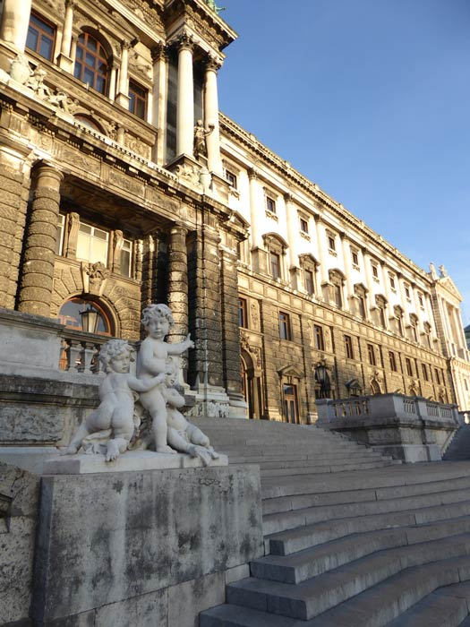 front of baroque palace building in vienna