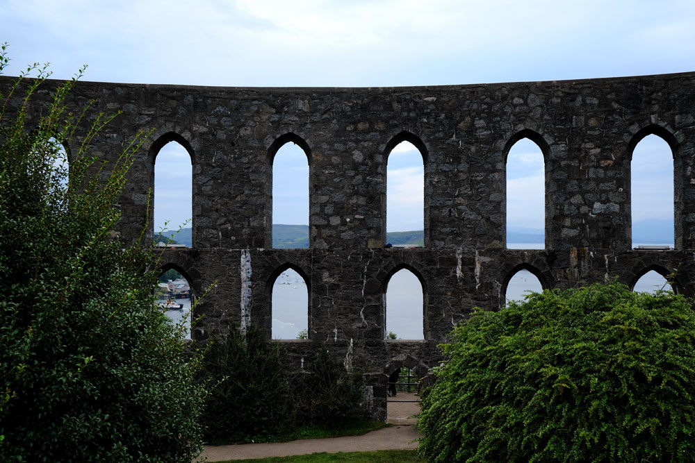 arches of mccaigs-tower-oban with bay in background