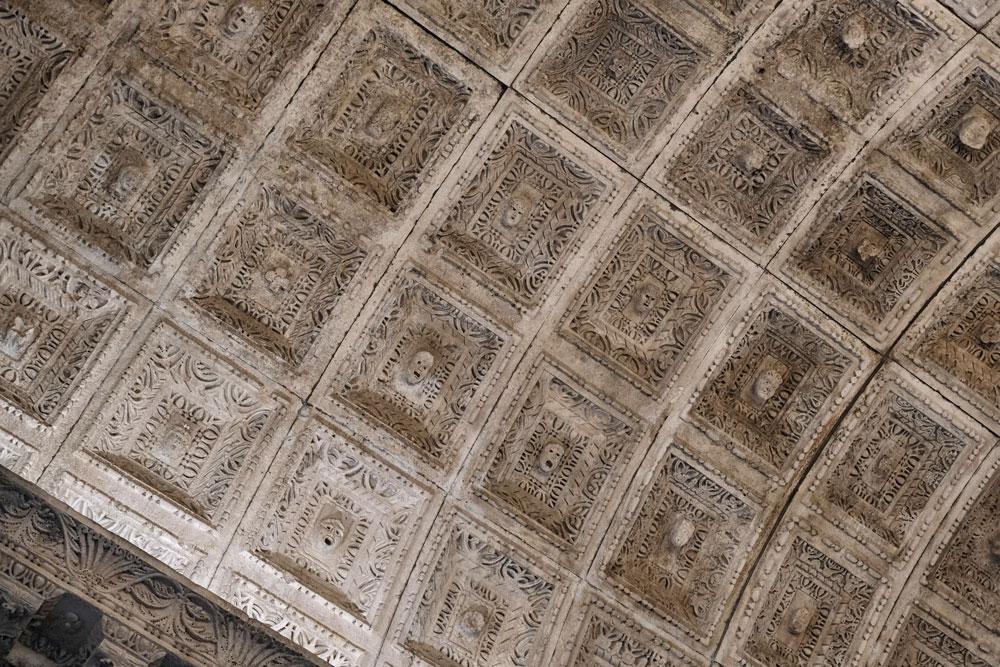 carved faces in ceiling of temple of jupiter split