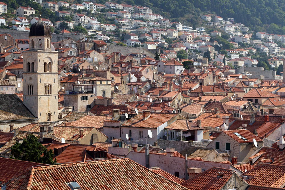 terracotta rooftops of dubrovnik with church bell tower