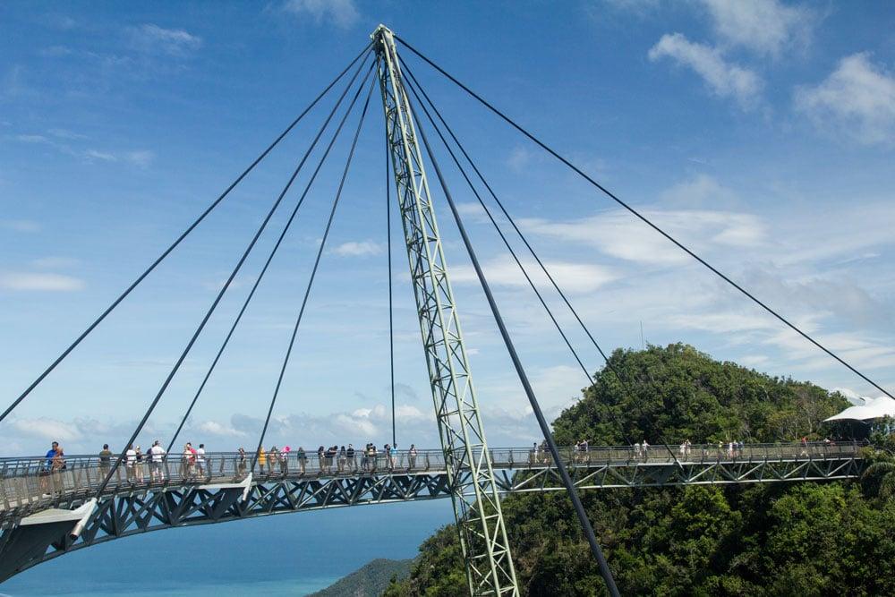 people walking across suspension bridge in langkawi malaysia