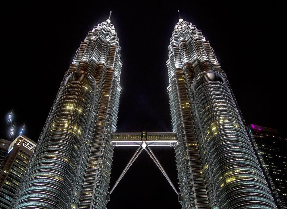the twin towers in kuala lumpur malaysia lit up at night