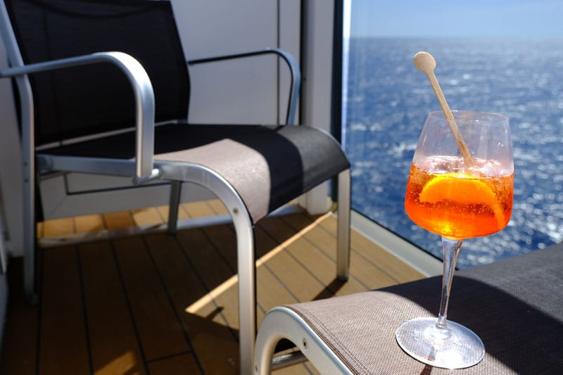 balcony of cabin on adriatic sea cruise with aperol spritz drink on table