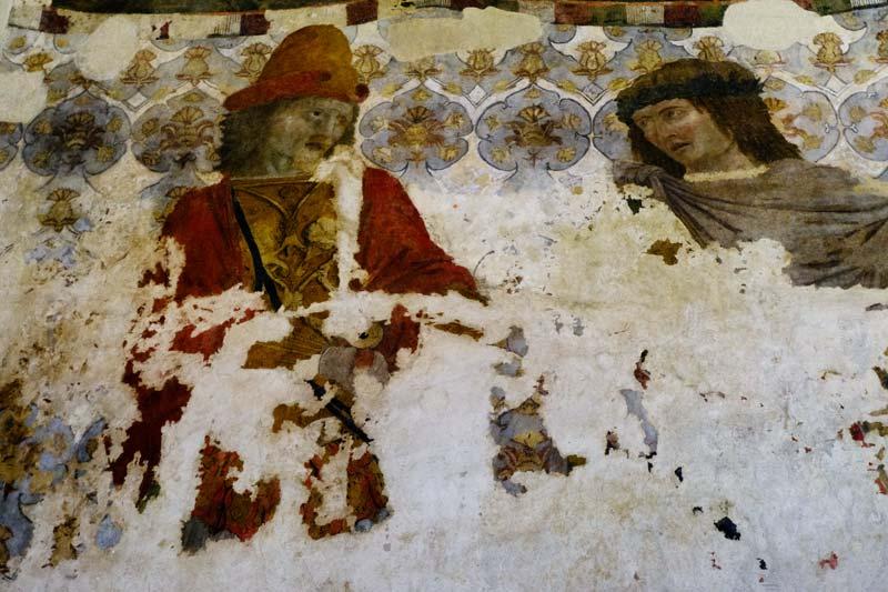 damaged renaissance painting of two men