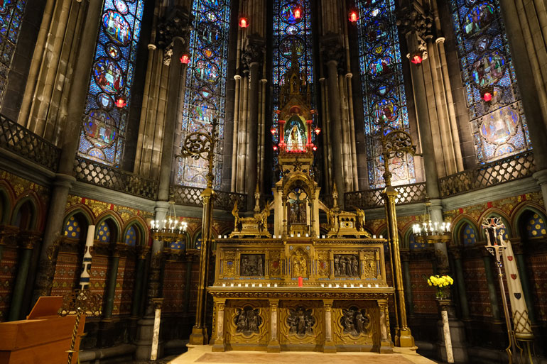 gilded altar and stained glass windows at La Sainte Chapelle, Lille Cathedral
