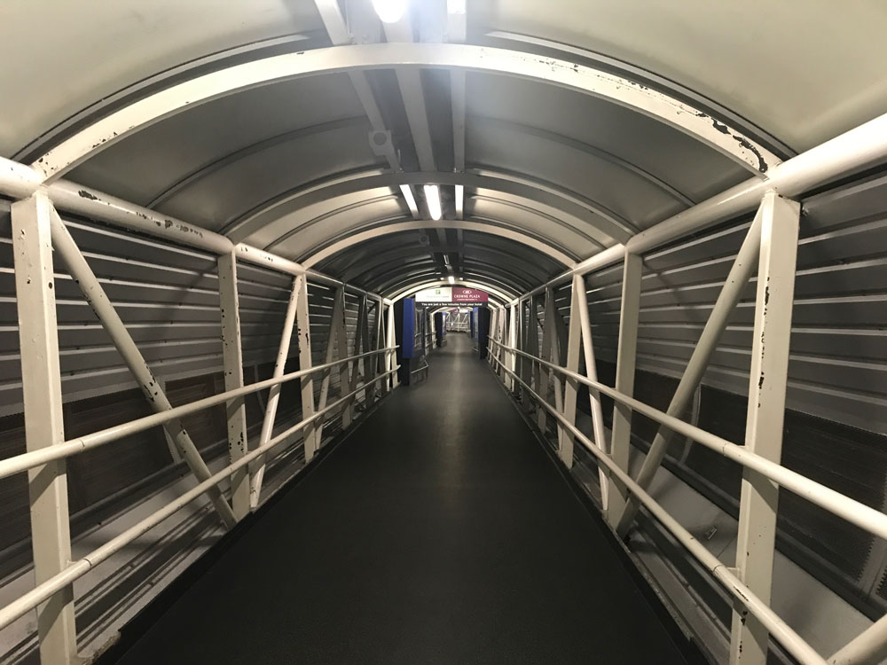covered footbridge to premier inn hotel at heathrow terminal 4