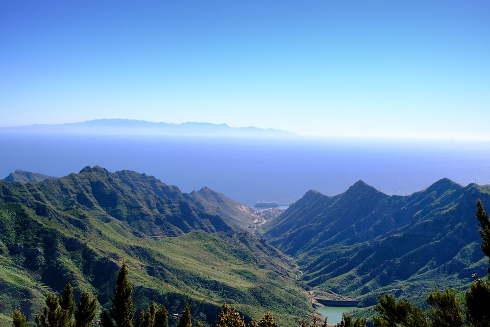 view of mountains lake and ocean against blue sky from anaga tenerife