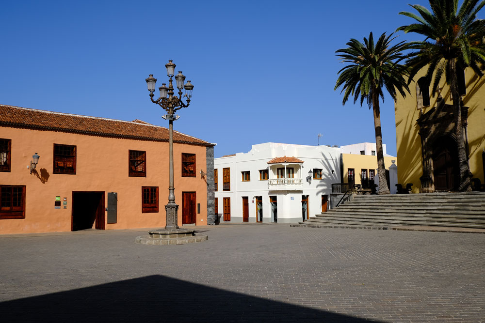 pizza with ochre coloured buidlings in Garachico, Tenerife