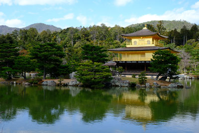 kinkakuji temple reflected in water in kyoto japan