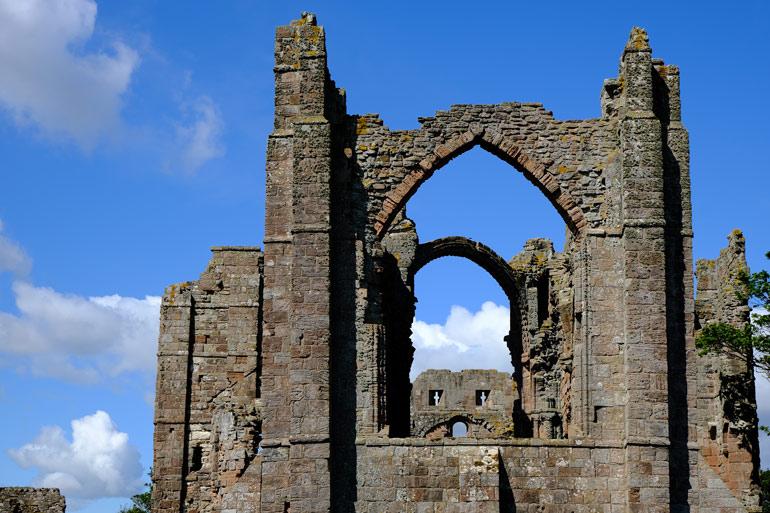 Lindisfarne Priory against blue sky