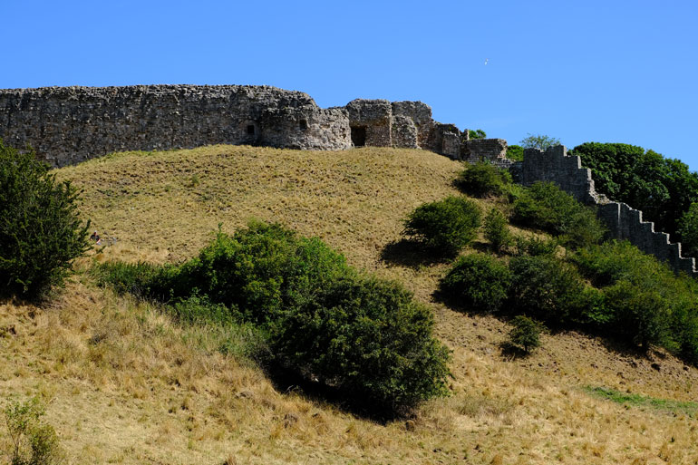 ruins of castle on grassy mound