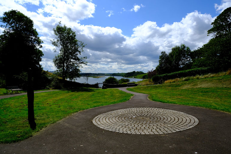 pathway in park leading to river in  Berwick-upon-Tweed