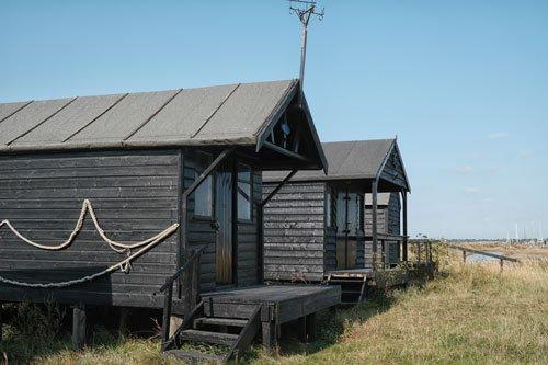 dark wood fishermens huts on walberswick beach