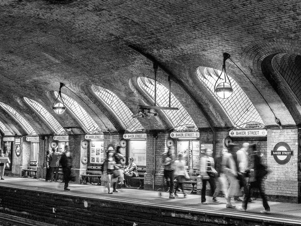 people on platform at baker street tube station in london