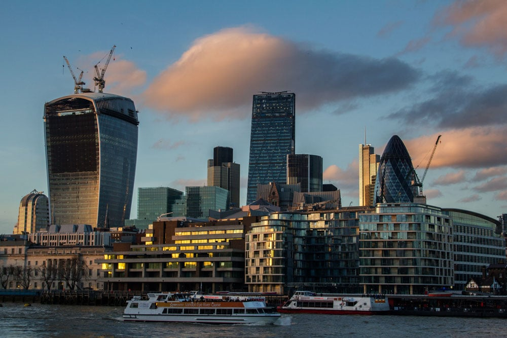 city skyline with the gherkin and walkie talkie building at sunset